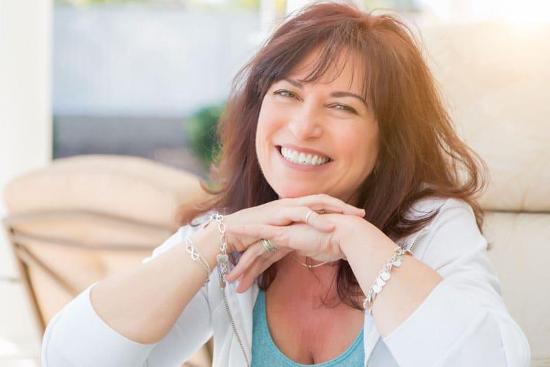 patient smiling after dental implants procedure